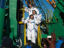 Expedition 34 Flight Engineers Chris<br /> Hadfield (top), Tom Marshburn (middle)<br /> and Roman Romanenko wave farewell<br /> from the bottom of the Soyuz rocket<br /> at the Baikonur Cosmodrome in<br /> Baikonur, Kazakhstan.<br /> Credit: NASA/Carla Cioffi